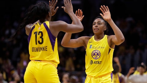<p>               Los Angeles Sparks' Chiney Ogwumike (13) and Nneka Ogwumike celebrate after a win over the Connecticut Sun during a WNBA basketball game Friday, May 31, 2019, in Los Angeles. (AP Photo/Marcio Jose Sanchez)             </p>