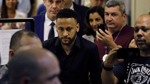 <p>               Brazilian soccer player Neymar leaves police headquarters in Rio de Janeiro, Brazil, Thursday, June 6, 2019. Neymar went to the headquarters in an investigation linked to a woman's rape allegation against him. (AP Photo/Leo Correa)             </p>