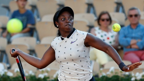<p>               A person in the stands holds a large tennis ball as Sloane Stephens of the U.S. eyes the ball as she plays a shot against Slovenia's Polona Hercog during their third round match of the French Open tennis tournament at the Roland Garros stadium in Paris, Friday, May 31, 2019. (AP Photo/Pavel Golovkin)             </p>