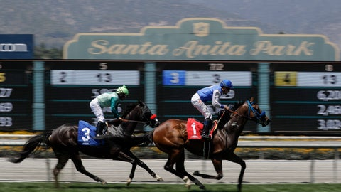 <p>               Eddie Haskell, right, with jockey Kent Desormeaux aboard, win the third race during the last day of the winter/spring meet at the Santa Anita horse racing track Sunday, June 23, 2019, in Santa Anita , Calif. (AP Photo/Chris Carlson)             </p>