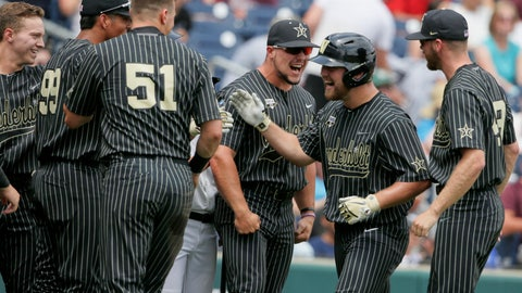 <p>               Vanderbilt's Stephen Scott second right, is greeted at the dugout after hitting a solo home run against Mississippi State in the second inning of an NCAA College World Series baseball game in Omaha, Neb., Wednesday, June 19, 2019. (AP Photo/Nati Harnik)             </p>