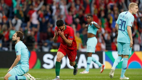 <p>               Portugal's Goncalo Guedes, centre, reacts after scoring his team's first goal during the UEFA Nations League final soccer match between Portugal and Netherlands at the Dragao stadium in Porto, Portugal, Sunday, June 9, 2019. (AP Photo/Armando Franca)             </p>