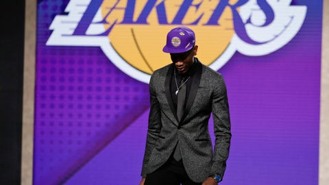 <p>               De'Andre Hunter, of Virginia, leaves the stage after being selected with the fourth pick overall by the Los Angeles Lakers during the NBA basketball draft Thursday, June 20, 2019, in New York. (AP Photo/Julio Cortez)             </p>
