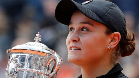 <p>               Australia's Ashleigh Barty holds the trophy as she celebrates winning her women's final match of the French Open tennis tournament against Marketa Vondrousova of the Czech Republic in two sets 6-1, 6-3, at the Roland Garros stadium in Paris, Saturday, June 8, 2019. (AP Photo/Christophe Ena)             </p>