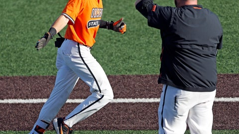 <p>               Oklahoma State's Hueston Morrill (1) reaches out to assistant coach James Vilade after hitting a home run during the fifth inning against Texas Tech in Game 2 of an NCAA college baseball tournament super regional Saturday, June 8, 2019, in Lubbock, Texas. (AP Photo/Brad Tollefson)             </p>