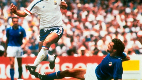 """<p>               FILE - In this file photo dated  June 17, 1986, Michel Platini, left, of France dribbles past Italian forward Alessandro Altobelli in their World Cup eight finals in Mexico City's Azteca Stadium.  France won 2-0 to advance to the quarterfinals of the tournament and Italy was eliminated. Affectionately nicknamed """"Le Roi"""" (The King), Michel Platini bestrode the soccer field with inimitable elegance as the world's best player of the early 1980s, but his lofty reputation seems to have been tainted.  (AP Photo, FILE)             </p>"""
