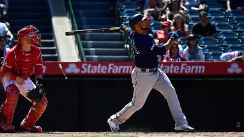 <p>               Seattle Mariners' Edwin Encarnacion, right, hits a two-run home run as Los Angeles Angels catcher Jonathan Lucroy watches during the seventh inning of a baseball game Sunday, June 9, 2019, in Anaheim, Calif. (AP Photo/Mark J. Terrill)             </p>