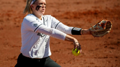 <p>               FILE - In this Feb. 14, 2019, file photo, Oklahoma State pitcher Samantha Show throws during an NCAA softball game in Clearwater, Fla. Show hit two homers and pitched a complete game to help Oklahoma State beat Florida 2-1, Thursday, May 30, 2019, in the Women's College World Series in Oklahoma City. (AP Photo/Casey Brooke Lawson, File)             </p>