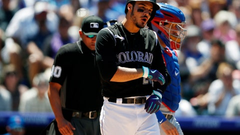 <p>               Colorado Rockies' Nolan Arenado reacts after getting hit in the arm by a pitch thrown by Chicago Cubs starting pitcher Cole Hamels in the third inning of a baseball game Wednesday, June 12, 2019, in Denver. (AP Photo/David Zalubowski)             </p>
