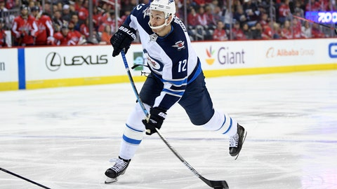 "<p>               FILE - In this March 10, 2019, file photo, Winnipeg Jets right wing Kevin Hayes (12) shoots the puck during the second period of an NHL hockey game against the Washington Capitals, in Washington. The Philadelphia Flyers have signed center Kevin Hayes to a $50 million, seven-year contract that's worth $7.14 million per season. Hayes should step in as the Flyers' new No. 2 center behind Sean Couturier. General manager Chuck Fletcher announced the deal Wednesday, June 19, 2019, file photo, saying the 6-foot-5, 216-pound Hayes ""plays a smart, two-way game and is just entering the prime of his career."" Philadelphia acquired Hayes' negotiating rights from Winnipeg for a fifth-round pick during the Stanley Cup Final. (AP Photo/Nick Wass, File)             </p>"