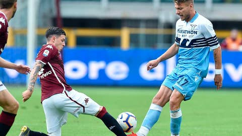 <p>               Torino's Daniele Baselli and Lazio's Ciro Immobile, right, go for the ball during the Serie A soccer match between Torino and Lazio at Olympic stadium in Turin, Italy, Sunday, May 26, 2019. (Alessandro Di Marco/ANSA via AP)             </p>
