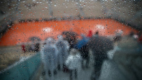 <p>               Rain drops trickle down a glass wall on center court where rain delayed the start of quarterfinal matches of the French Open tennis tournament at the Roland Garros stadium in Paris, Wednesday, June 5, 2019. (AP Photo/Christophe Ena)             </p>