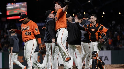 <p>               San Francisco Giants relief pitcher Will Smith, front right, celebrates with assistant hitting coach Rick Schu after the Giants defeated the Milwaukee Brewers 5-3 in a baseball game in San Francisco, Friday, June 14, 2019. (AP Photo/Jeff Chiu)             </p>