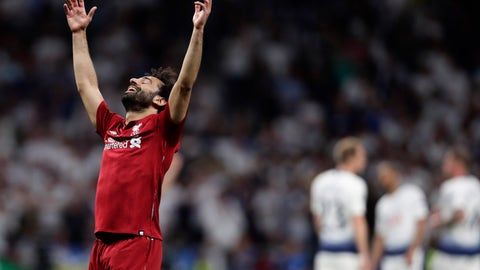<p>               Liverpool's Mohamed Salah celebrates their victory after winning during the Champions League final soccer match between Tottenham Hotspur and Liverpool at the Wanda Metropolitano Stadium in Madrid, Saturday, June 1, 2019. (AP Photo/Manu Fernandez)             </p>