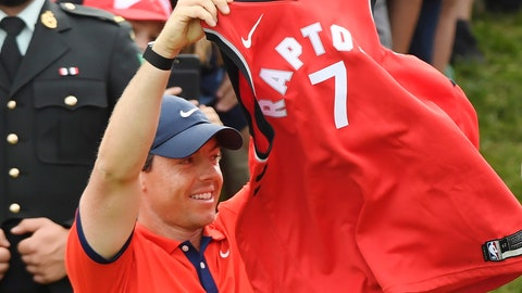 <p>               Rory McIlroy, of Northern Ireland, raises a Toronto Raptors jersey on the 18th green after winning the Canadian Open golf championship in Ancaster, Ontario, Sunday, June 9, 2019. (Nathan Denette/The Canadian Press via AP)             </p>