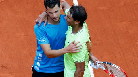 <p>               Spain's Rafael Nadal, right, hugs Austria's Dominic Thiem after their men's final match of the French Open tennis tournament at the Roland Garros stadium in Paris, Sunday, June 9, 2019. Nadal won 6-3, 5-7, 6-1, 6-1. (AP Photo/Pavel Golovkin)             </p>