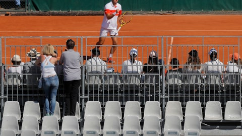 <p>               Two spectators watch a match from an adjacent court at the French Open tennis tournament at the Roland Garros stadium in Paris, Saturday, June 1, 2019. (AP Photo/Michel Euler)             </p>