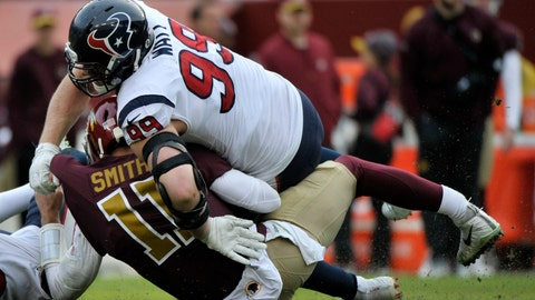 "<p>               FILE - In this Nov. 18, 2018, file photo, Washington Redskins quarterback Alex Smith (11) injuries his leg on a sack by Houston Texans strong safety Kareem Jackson (25) and defensive end J.J. Watt (99) during an NFL football game in Landover, Md.  Alex Smith says he hopes to play football again but still needs to make such basic progress as relearning how to run on his broken right leg. In an interview during a massage at a mall with ""The Oh My Goff Show,"" posted Friday, June 21, 2019, on YouTube, Smith said ""the steps I'm at right now are lifestyle steps,"" such as being able to play around with his kids. Asked whether he will return to football, Smith replied, ""That's the plan.""(AP Photo/Mark Tenally, File)             </p>"
