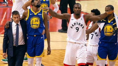 <p>               Golden State Warriors forward Kevin Durant (35) walks off the court after sustaining an injury as Toronto Raptors center Serge Ibaka (9) gestures to the crowd during first half basketball action in Game 5 of the NBA Finals in Toronto on Monday, June 10, 2019. (Chris Young/The Canadian Press via AP)             </p>