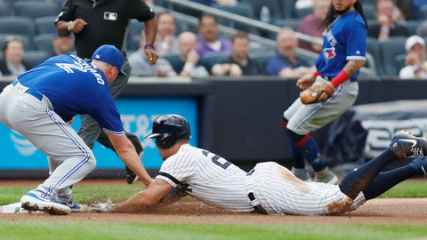 <p>               Toronto Blue Jays starting pitcher Clayton Richard, left, tags out New York Yankees' Giancarlo Stanton at third during the first inning of a baseball game Tuesday, June 25, 2019, in New York. Stanton left the game after the third inning. (AP Photo/Kathy Willens)             </p>