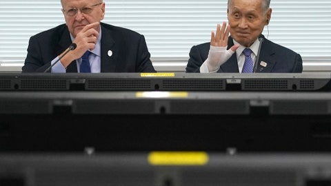 """<p>               FILE - In this May 21, 2019, file photo, John Coates, left, chairman of the IOC Coordination Commission for the 2020 Tokyo Olympics and Paralympics, Tokyo Olympic organizing committee President Yoshiro Mori, right, attend the IOC Coordination Commission opening plenary session of the Olympic Games Tokyo 2020 in Tokyo. A top Olympic official has made a guarantee that should please world sports federations that are concerned that organizers of next year's Tokyo games might be cutting things that federations view as """"essential."""" (AP Photo/Eugene Hoshiko, File)             </p>"""
