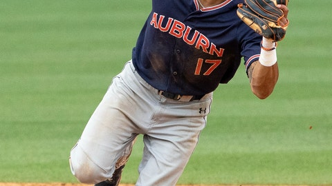"""<p>               FILE - In this June 8, 2019, file photo, Auburn's Will Holland (17) fields a ground ball against North Carolina during Game 1 at the NCAA college baseball super regional tournament, in Chapel Hill, N.C. The College World Series has an even stronger Southeastern Conference flavor than usual. """"We're just a gritty group of guys,"""" Auburn shortstop Will Holland said. """"We don't stop.''(AP Photo/Ben McKeown, File)             </p>"""