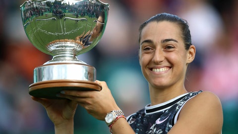 <p>               France's Caroline Garcia holds the trophy after beating Croatia's Donna Vekic, to win the women's singles final during day nine of the Nottingham Cup Open tennis championship in Nottingham, England, Sunday June 16, 2019. (Tim Goode/PA via AP)             </p>