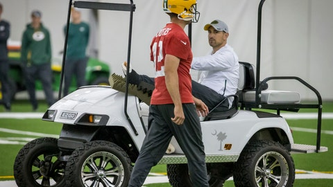 <p>               Quarterback Aaron Rodgers, left, walks past head coach Matt LaFleur during an NFL football practice in Green Bay, Wisc., Wednesday, June 12, 2019. LeFleur is recovering from a torn Achilles. (AP Photo/Mike Roemer)             </p>