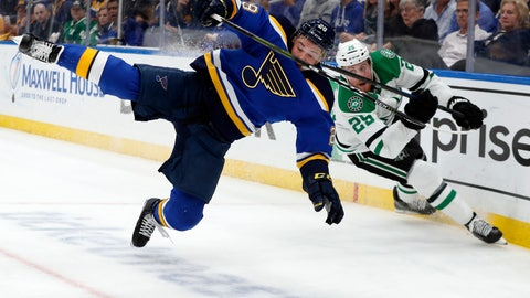 <p>               FILE - In this May 7, 2019, file photo, St. Louis Blues defenseman Vince Dunn (29), left, and Dallas Stars right wing Brett Ritchie (25) compete for control of a loose puck during the first period in Game 7 of an NHL second-round hockey playoff series in St. Louis. Dunn is expected to return to the St. Louis Blues lineup in Game 4 of the Stanley Cup Final against the Boston Bruins after missing almost three weeks with facial injuries and a suspected concussion. (AP Photo/Jeff Roberson, File)             </p>