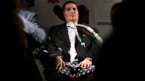 <p>               FILE -In this Sept. 18, 2017 photograph, Pete Frates, who is stricken with amyotrophic lateral sclerosis, or ALS, listens to a guest at Fenway Park in Boston. On Thursday, June 27, 2019, Boston College unveiled plans for the Pete Frates Center, a new indoor baseball and softball training facility that will be named after the alumnus who helped popularize the ice bucket challenge. (AP Photo/Charles Krupa, File)             </p>