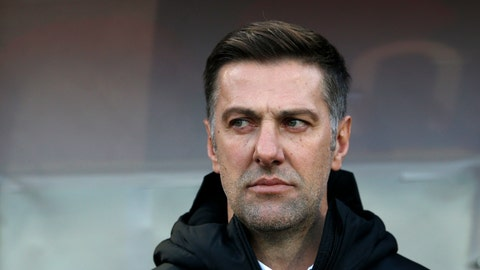 <p>               In this Saturday Nov. 17, 2018, Serbia coach Mladen Krstajic looks out from the bench prior the UEFA Nations League soccer match between Serbia and Montenegro at Rajko Mitic stadium in Belgrade, Serbia. Serbia's soccer association has fired national team coach Mladen Krstajic after a humiliating loss against Ukraine in a European Championship qualifier. Krstajic, a former national team defender and Bundesliga veteran, was named the national team coach ahead of the World Cup in Russia last year despite having never held a previous coaching position. (AP Photo/Darko Vojinovic, File)             </p>