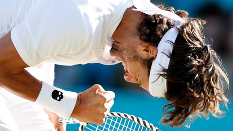 <p>               Feliciano Lopez of Spain reacts after scoring a point against Felix Auger-Aliassime of Canada during their men's singles semifinal match at the Queens Club tennis tournament in London, Saturday, June 22, 2019. (AP Photo/Alastair Grant)             </p>