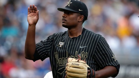 <p>               Vanderbilt pitcher Kumar Rockeer (80) walks off the mound in the second inning against Michigan in Game 2 of the NCAA College World Series baseball finals in Omaha, Neb., Tuesday, June 25, 2019. (AP Photo/Nati Harnik)             </p>