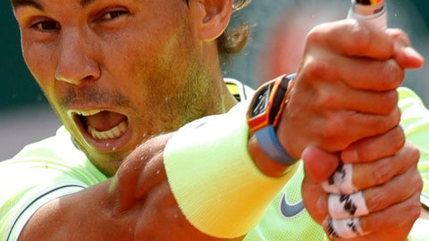 <p>               Spain's Rafael Nadal plays a shot against Japan's Kei Nishikori during their quarterfinal match of the French Open tennis tournament at the Roland Garros stadium in Paris, Tuesday, June 4, 2019. (AP Photo/Pavel Golovkin)             </p>