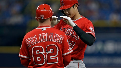 <p>               Los Angeles Angels' Shohei Ohtani, right, of Japan, celebrates with first base coach Jesus Feliciano after his single off Tampa Bay Rays' Hunter Wood, completing the cycle during the seventh inning of a baseball game Thursday, June 13, 2019, in St. Petersburg, Fla. (AP Photo/Chris O'Meara)             </p>