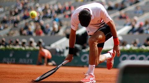 <p>               Serbia's Novak Djokovic reacts after missing a shot against Austria's Dominic Thiem during the men's semifinal match of the French Open tennis tournament at the Roland Garros stadium in Paris, Saturday, June 8, 2019. (AP Photo/Christophe Ena)             </p>
