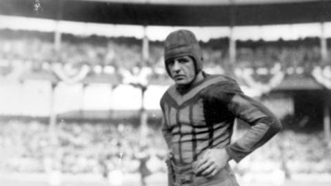 <p>               In this 1925, file photo, American football player Red Grange of the Chicago Bears is shown during a game against the New York Giants in New York. As the NFL enters its 100th season, what players wear on the field may have changed the most, going from leather helmets and long-sleeved turtlenecks and sweaters to plastic helmets with jerseys and pants almost shrink-wrapped to fit.(AP Photo/File)             </p>