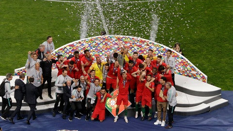 <p>               Portugal's Cristiano Ronaldo lifts up the trophy as he celebrates with players after winning the UEFA Nations League final soccer match between Portugal and Netherlands at the Dragao stadium in Porto, Portugal, Sunday, June 9, 2019. (AP Photo/Luis Vieira)             </p>