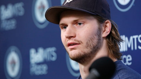 <p>               FILE - In this April 22, 2019, file photo, Winnipeg Jets' Jacob Trouba speaks to the media at their closing press conference after losing in the first round of the NHL playoffs, in Winnipeg, Manitoba.  Trouba not wanting to sign a long-term deal in Winnipeg was well-documented. Less so was a big reason why. After being traded to the New York Rangers on Monday night, June 17, 2019, Trouba revealed his fiancée's aspirations to be a doctor played a role in wanting to play in the United States. (John Woods/The Canadian Press via AP, File)             </p>
