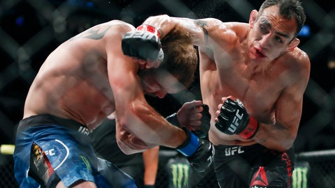 <p>               Tony Ferguson, right, punches Donald Cerrone, left, during their lightweight mixed martial arts bout at UFC 238, Saturday, June 8, 2019, in Chicago. (AP Photo/Kamil Krzaczynski)             </p>