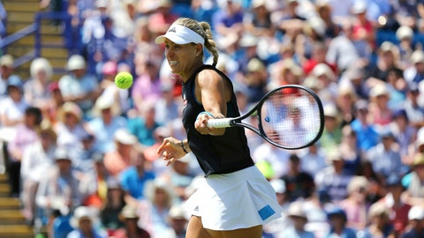 <p>               Angelique Kerber in action against Simona Halep during the singles match at the Eastbourne Open tennis tournament at Devonshire Park, Eastbourne, England, Thursday June 27, 2019. (Gareth Fuller/PA via AP)             </p>
