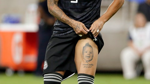 <p>               Mexico defender Carlos Salcedo (3) reacts and shows a leg tattoo of his son after making the winning penalty kick against Costa Rica during the shootout after extra time in a CONCACAF Gold Cup soccer quarterfinal  Saturday, June 29, 2019, in Houston. (AP Photo/Michael Wyke)             </p>
