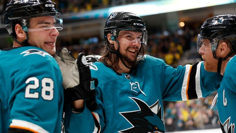 <p>               FILE - In this Feb. 16, 2019, file photo, San Jose Sharks' Erik Karlsson, center, celebrates with Timo Meier, left, and Joe Pavelski after Pavelski scored during the third period of an NHL hockey game against the Vancouver Canuck, in San Jose, Calif. The San Jose Sharks re-signed pending free agent Erik Karlsson to an eight-year deal on Monday, June 17, 2019, turning a one-year rental into a long-term commitment to one of the league's most dynamic defensemen.(AP Photo/Josie Lepe, File)             </p>