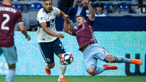 <p>               Vancouver Whitecaps' Ali Adnan (53) plays the ball as Colorado Rapids' Diego Rubio (7) falls during the second half of an MLS soccer match Saturday, June 22, 2019, in Vancouver, British Columbia. (Ben Nelms/The Canadian Press via AP)             </p>