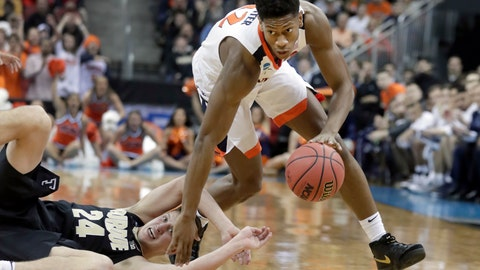 <p>               FILE - In this March 30, 2019, file photo, Virginia's De'Andre Hunter dribbles past Purdue's Grady Eifert (24) during the first half of a men's NCAA Tournament college basketball South Regional final game, in Louisville, Ky. Hunter is a high prospect in the NBA Draft on Thursday, June 20. (AP Photo/Michael Conroy, File)             </p>