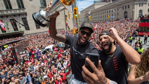 <p>               Toronto Raptors' Kawhi Leonard holds his MVP trophy while celebrating with rapper/producer Drake during the team's NBA basketball championship parade in Toronto, Monday, June 17, 2019. (Frank Gunn/The Canadian Press via AP)             </p>
