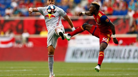 <p>               New York Red Bulls defender Amro Tarek and Real Salt Lake forward Sam Johnson (50) battle for the ball during the first half of an MLS soccer match Saturday, June 1, 2019, in Harrison, N.J. (AP Photo/Adam Hunger)             </p>