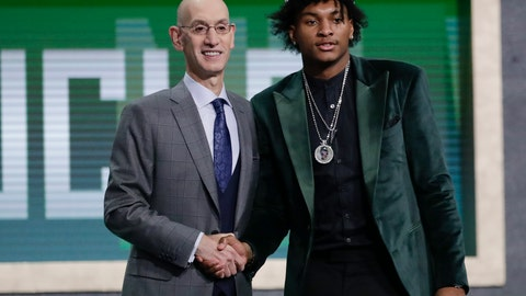 <p>               NBA Commissioner Adam Silver poses for photographs with Southern California's Kevin Porter Jr. after the Milwaukee Bucks selected him as the 30th pick overall in the NBA basketball draft Thursday, June 20, 2019, in New York. (AP Photo/Julio Cortez)             </p>