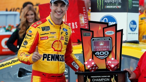 <p>               Joey Logano stands with the trophy after winning a NASCAR Cup Series auto race at Michigan International Speedway, Monday, June 10, 2019, in Brooklyn, Mich. (AP Photo/Carlos Osorio)             </p>