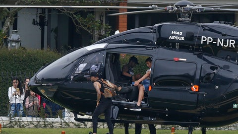 <p>               Brazil's soccer player sits inside his helicopter as teammates Thiago Silva, right, and Daniel Alves, left, exit as they arrive to the Granja Comary training center to train for the Copa America tournament in Teresopolis, Brazil, Sunday, June 2, 2019. A Brazilian police document says an unidentified woman has accused soccer star Neymar of raping her in Paris last month. After the revelation, the player used Instagram to publish a 7-minute video that includes WhatsApp messages he says he exchanged with the accuser in a friendly way days later. (AP Photo/Leo Correa)             </p>